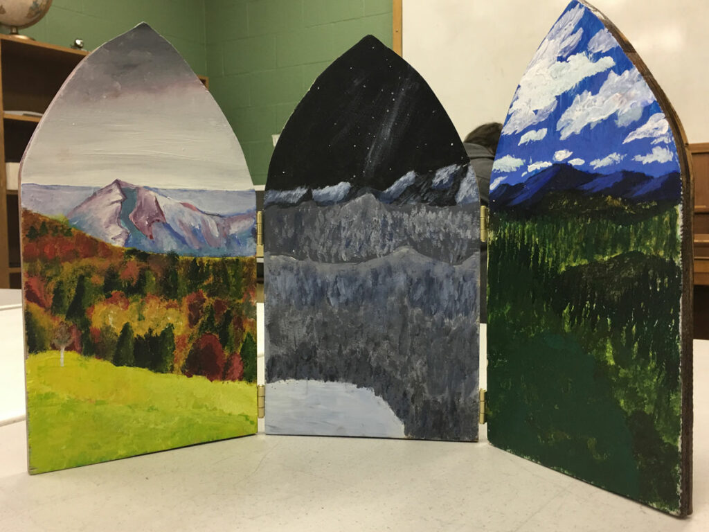 Triptych (Grade 10) - Acrylic on board. This is a cohort project created by three students, who each panted a panel with part of the same landscape in a different season.
